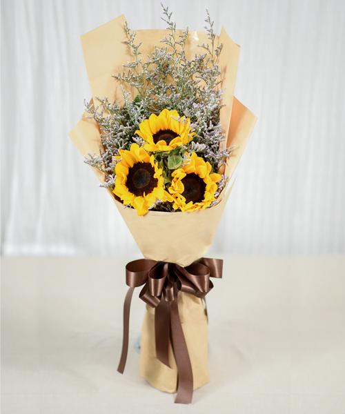 ช่อดอกทานตะวัน ห่อด้วยกระดาษสีเหลือง